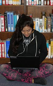 Gav Student studying in the library